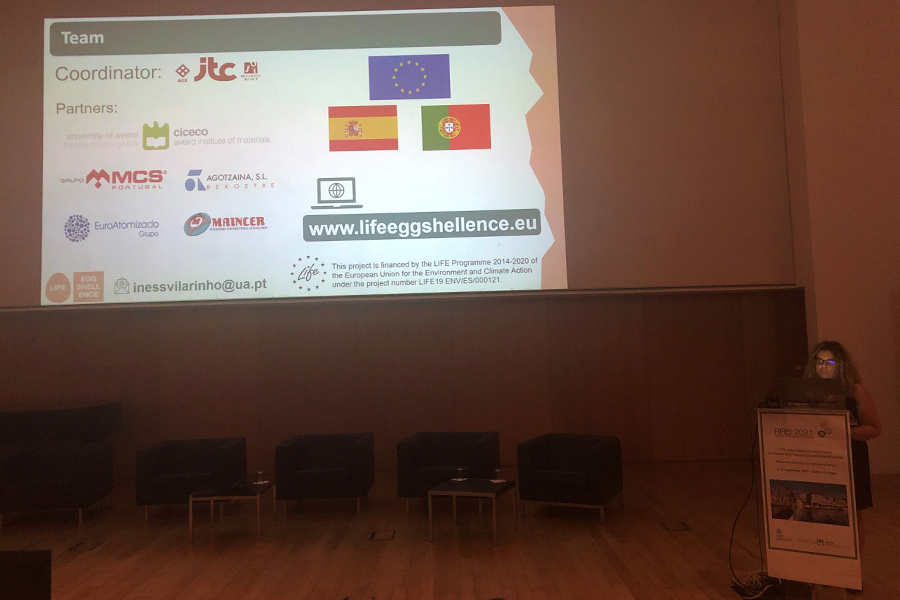"""The LIFE EGGSHELLENCE project, funded by the European Union (REF. : LIFE 19 ENV/ES/00121 through the 2014-2020 programme for Environment and Climate Action, was presented last 6th September at the 17th International Conference RRB 2021 (Renewable Resources and Biorefineries), concretely at the Santiago Campus of the University of Aveiro (Portugal) and in the framework of the BioBased Market, an experience in which companies, start-ups, institutes and research centres were able to present their innovative projects in terms of bioproducts or bio-based products, i.e. materials, chemical products and energy derived from renewable biological resources. Thus, the project was presented by means of a booth where the raw materials, our bio-based tile and an illustrative poster were shown. In addition, in the so-called """"pitch session"""", by an oral presentation, the LIFE EGGSHELLENCE project was presented to research groups from all over the world, leaders in renewable resources and in the path towards the sustainability of the planet."""